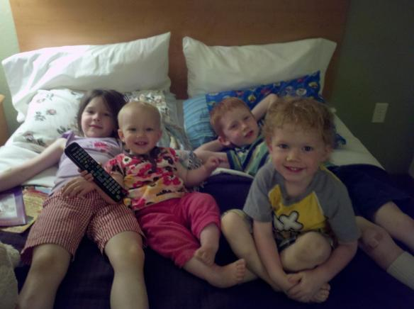 Four kids hanging out in the hotel with Mom.  As you might guess from all the smiles, this was not the trip with the stomach flu.