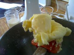 Finished homemade butter with buttermilk in the background.  Flavorful, fresh, and delicious.