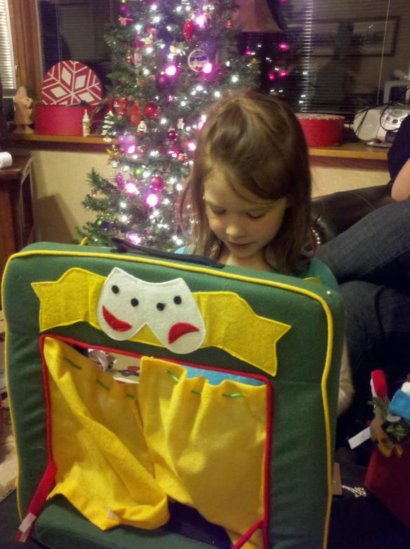An early Christmas present puppet theatre makes a very happy girl.