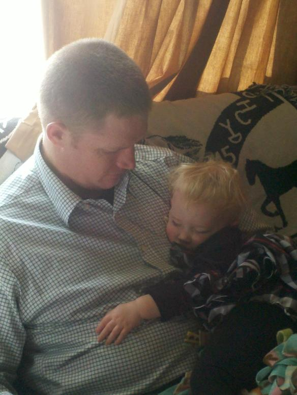 Our baby takes a Thanksgiving nap on Dad just before the big meal.