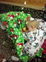 Snuggling in with the new Christmas blankets before bed on Christmas Eve.