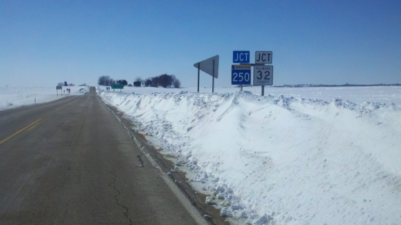 No signs of spring around here, where the road signs are still up to their necks in snow.