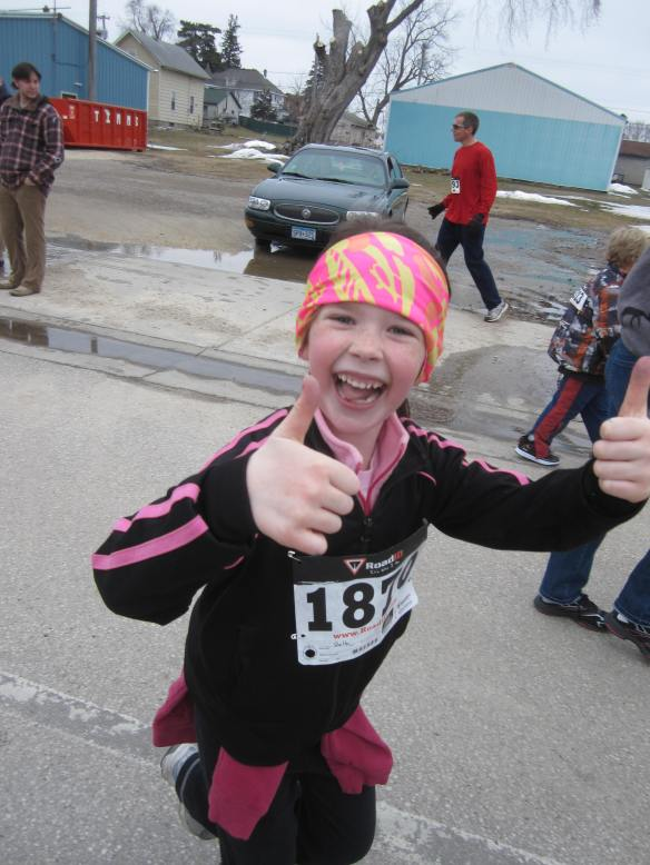 My daughter, now seven, giving two thumbs up during the Fool's Five race.