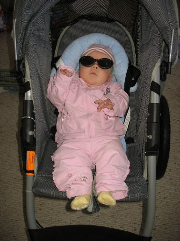 "My daughter at two months, out for her very first ""run"" in 2006."