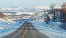 Snow-covered mountain plateaus in the distance and sweeping views on our drive on the snowy Hwy 212 in south-eastern Montana.