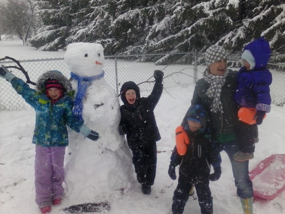My kiddos and I making the best of the crazy May snowstorm by building a snowman.