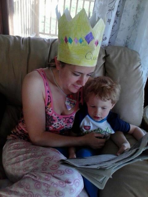 Wearing new my crown and  locket, reading a special letter to my three-year-old.
