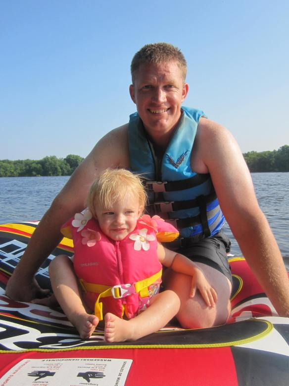 "On the Mississippi: Our very proud two-year-old after her first tube ride with her dad. ""I no fall off, Mom!"""