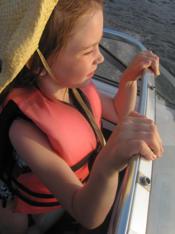 My daughter on the Mississippi river, taking in the sunset and breeze.