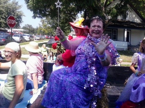 My mom, Mary Kramer, waving her magic wand during the Gladiolus Days parade.