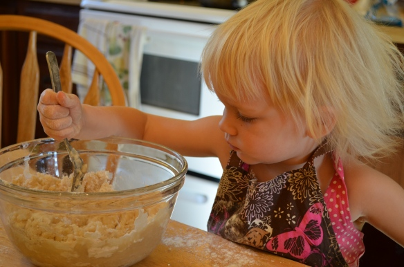 Concentrating on mixing up the pie crust.