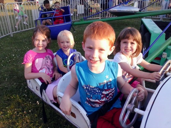 Four cousins on a beautiful night at the fair.  (Always take pictures early on at the fair, while the kids are still smiling.)