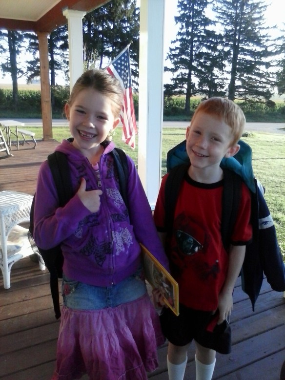 7:15 AM: First day of school, two kids ready for a great new start to the year, heading off to 2nd grade and 1st grade.