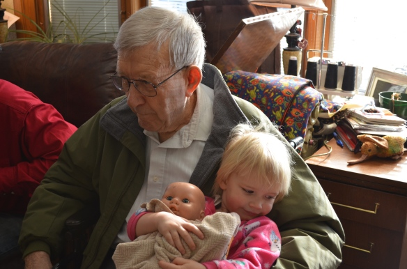 Being held by Great Grandpa Thelmer on Thanksgiving morning is just fine.